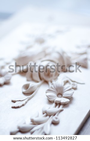 beautiful stucco plaster in the form of flowers - stock photo