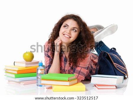 Beautiful student girl with books lying on floor, isolated on white background - stock photo