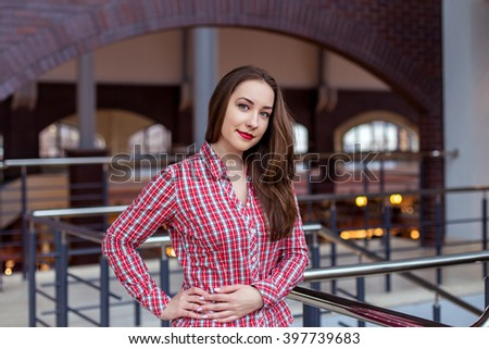 beautiful student in shirt smiling in University - stock photo