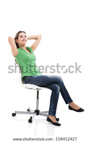 Beautiful student sitting on a chair, isolated over a white background - stock photo