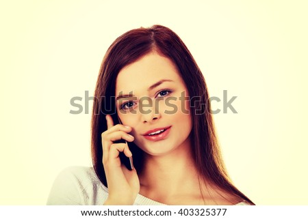 Beautiful student woman talking through a  mobile phone - stock photo