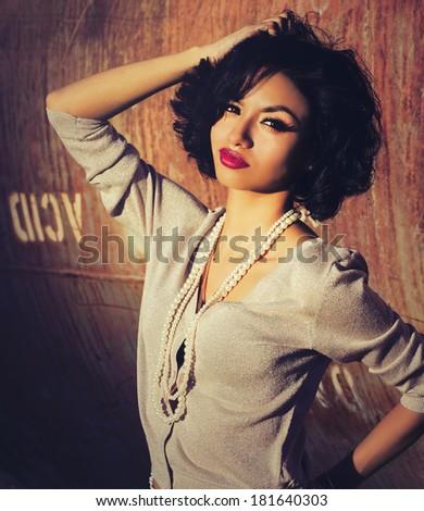 Beautiful stylish exotic young woman fashion portrait - stock photo
