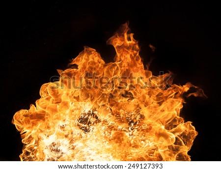 Beautiful stylish fire flames, close-up. - stock photo
