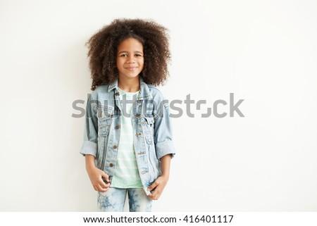 Beautiful stylish little girl in jean jacket - stock photo