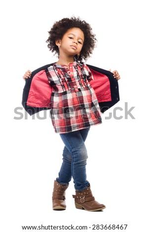 Beautiful stylish little girl with leather bag - stock photo
