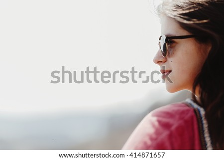 beautiful stylish woman hipster smiling portrait in fashionable sunglasses in summer mountains, space for text travel concept - stock photo