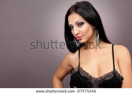 Beautiful stylish woman isolated on studio background - stock photo