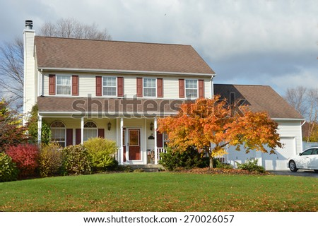Beautiful Suburban McMansion Home autumn day overcast cloudy sky residential neighborhood USA - stock photo