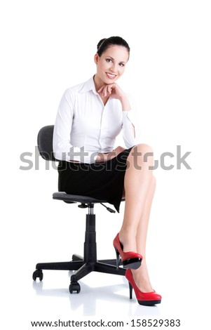 Beautiful successful businesswoman sitting on ofice chair and smiling, isolated on white  - stock photo