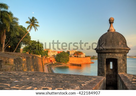 Beautiful summer afternoon at the outer wall with sentry box of fort San Felipe del Morro in old San Juan in Puerto Rico - stock photo
