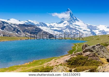 Beautiful summer Alpine mountain lake view  - stock photo