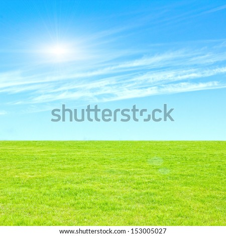 Beautiful Summer Background Landscape With Blue Sky And Green Grass.  - stock photo
