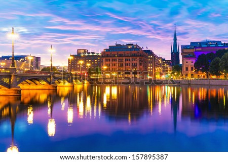 Beautiful summer evening scenery of sunset in the Old Town (Gamla Stan) architecture near the Vasa Bridge (Vasabron) in Stockholm, Sweden - stock photo