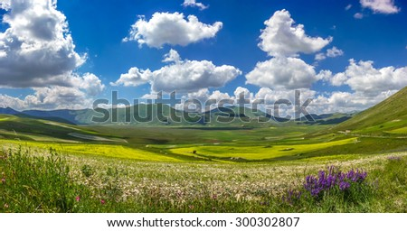 Beautiful summer landscape at Piano Grande (Great Plain) mountain plateau in the Apennine Mountains, Castelluccio di Norcia, Umbria, Italy - stock photo