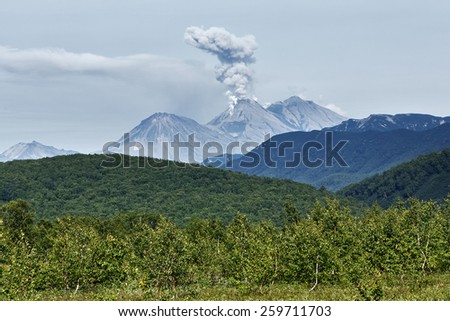 Beautiful summer landscape of Kamchatka Peninsula: view on eruption active volcano. Russia, Far East - stock photo