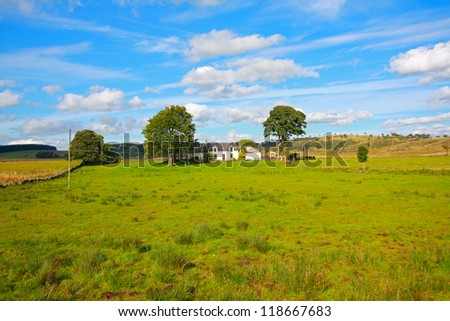 Beautiful summer landscape with a white house - stock photo
