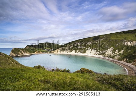 Beautiful Summer morning landscape over Lulworth Cove in England - stock photo