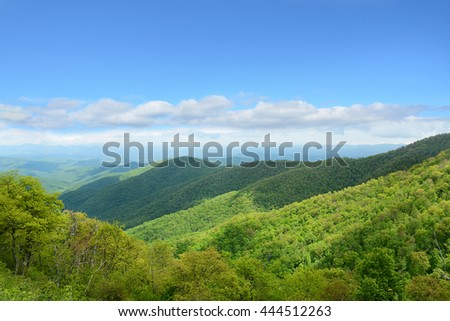 Beautiful summer mountain landscape. Blue sky with white clouds in the background. Copy space. North Carolina. Blue Ridge Parkway.USA - stock photo