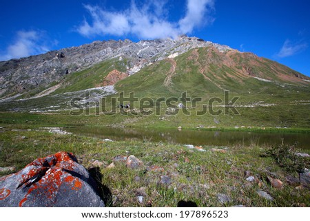 beautiful summer mountain landscape cliffs and wonderful clouds on blue sky  - stock photo