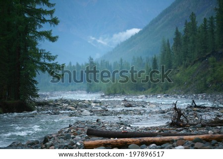 beautiful summer mountain landscape river, cliffs, forests and wonderful clouds on blue sky  - stock photo