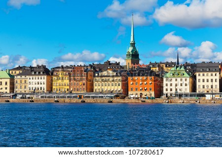 Beautiful summer scenery of the Old Town (Gamla Stan) pier and skyline in Stockholm, Sweden - stock photo