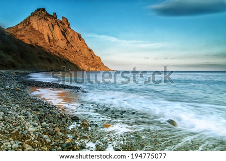 beautiful summer seascape with mountain and waves, natural background - stock photo