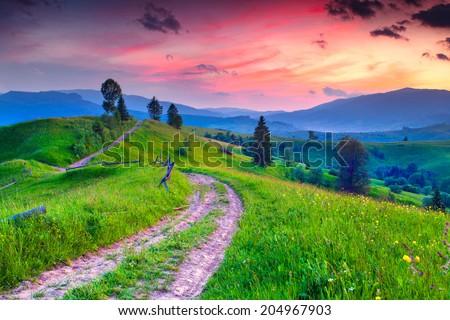 Beautiful summer sunrise in the mountain village - stock photo