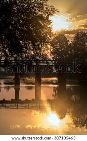 Beautiful summer sunrise over the river Krka, Slovenia. - stock photo