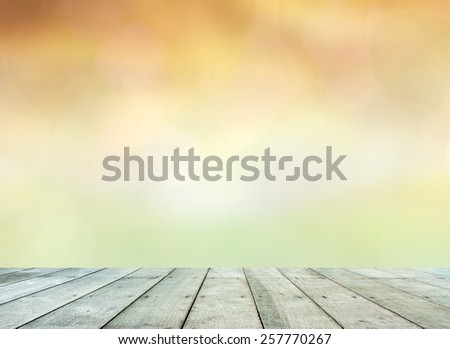 Beautiful Summer sunset over golden beach landscape with wooden planks floor - stock photo