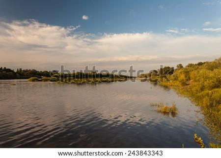 Beautiful summer water landscape in sunbeam. Ukraine - stock photo