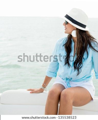 Beautiful summer woman sailing in a boat - stock photo