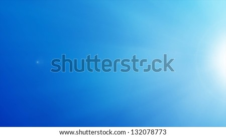Beautiful sun over blue sky. - stock photo