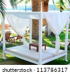 Beautiful sunbeds on beach - stock photo