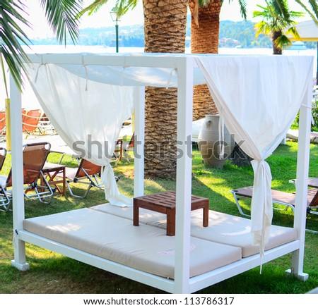 Beautiful sunbeds on beach - stock photo