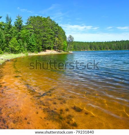 Beautiful sunny day on a northwoods Wisconsin Lake - stock photo