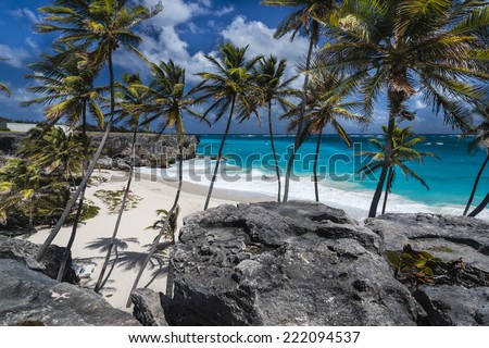 Beautiful sunny day on the stunning tropical beach at Bottom Bay, Barbados, West Indies. - stock photo