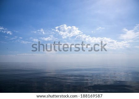 Beautiful sunny day with blue sky over the sea. Calm. - stock photo