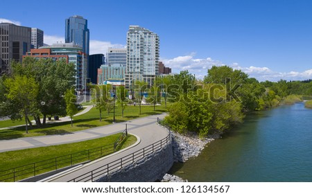 Beautiful sunny summer day in Calgary Downtown; image taken from certre street bridge, overlooking north side of dowtown and Bow River. - stock photo
