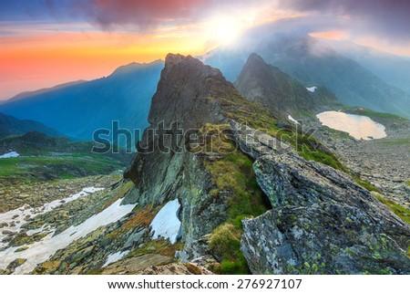 Beautiful sunrise and narrow ridges in the Fagaras mountains,Carpathians,Transylvania,Romania,Europe - stock photo