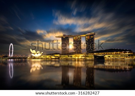 Beautiful sunrise at marina bay, Singapore city skyline, Singapore - stock photo