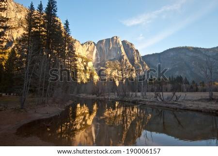 Beautiful sunrise at swinging bridge in Yosemite National Park - stock photo