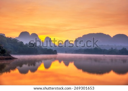 Beautiful sunrise at the nongtalay lake in krabi Province,Thailand - stock photo