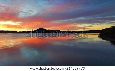 Beautiful sunrise from  Koolewong and reflections on the Brisbane Waters with picturesque views to Woy Woy Channel, Pelican Island and Saratoga, magnificent, sky, clouds,  - stock photo