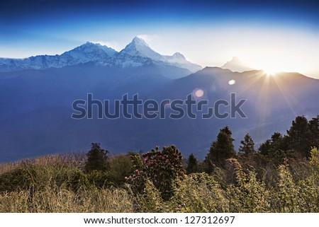 Beautiful sunrise in Himalaya mountains - stock photo