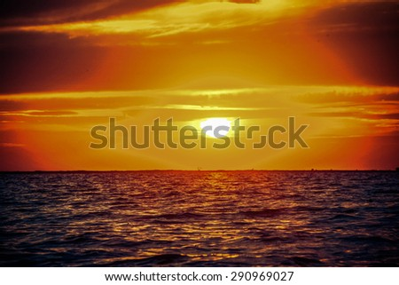 Beautiful sunrise in the sea - stock photo