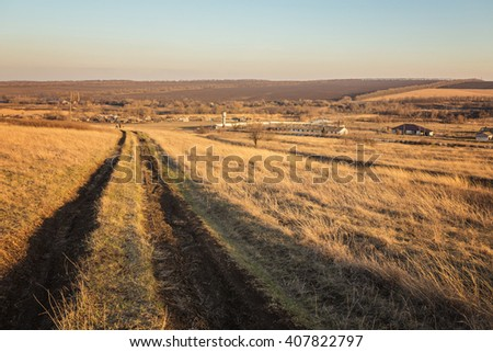 Beautiful Sunrise in the steppe over the Dirt road. Summer landscape. - stock photo