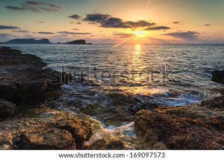 Beautiful sunrise landscape seascape over rocky coastline in Mediterranean Sea - stock photo