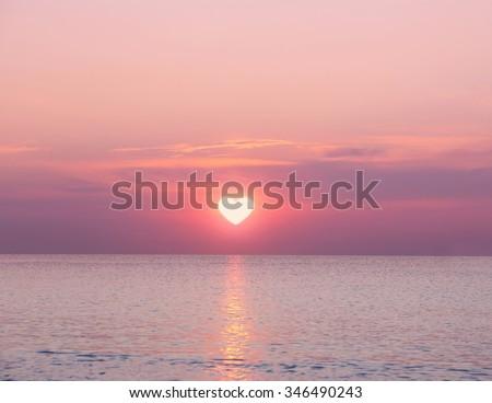 Beautiful sunrise on sea background - stock photo