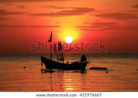 Beautiful sunrise over fishing boats in the morning in Songkhla Thailand. - stock photo