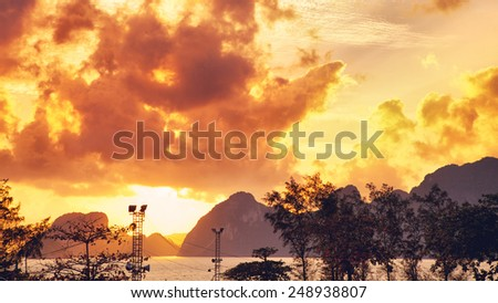 beautiful sunrise over mountain shore, samui, thailand - stock photo